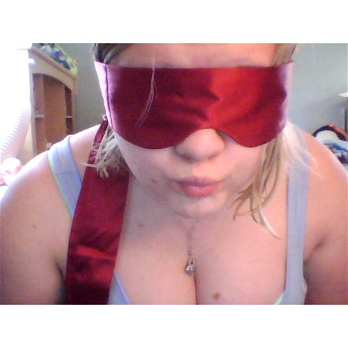 Adore me blindfold on